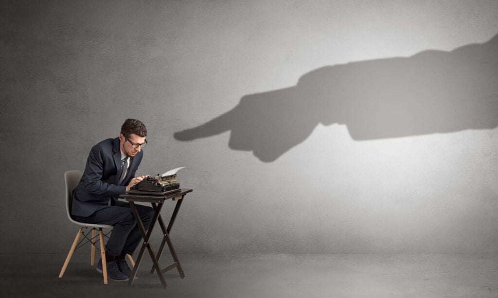 Shadow finger pointing at a office worker