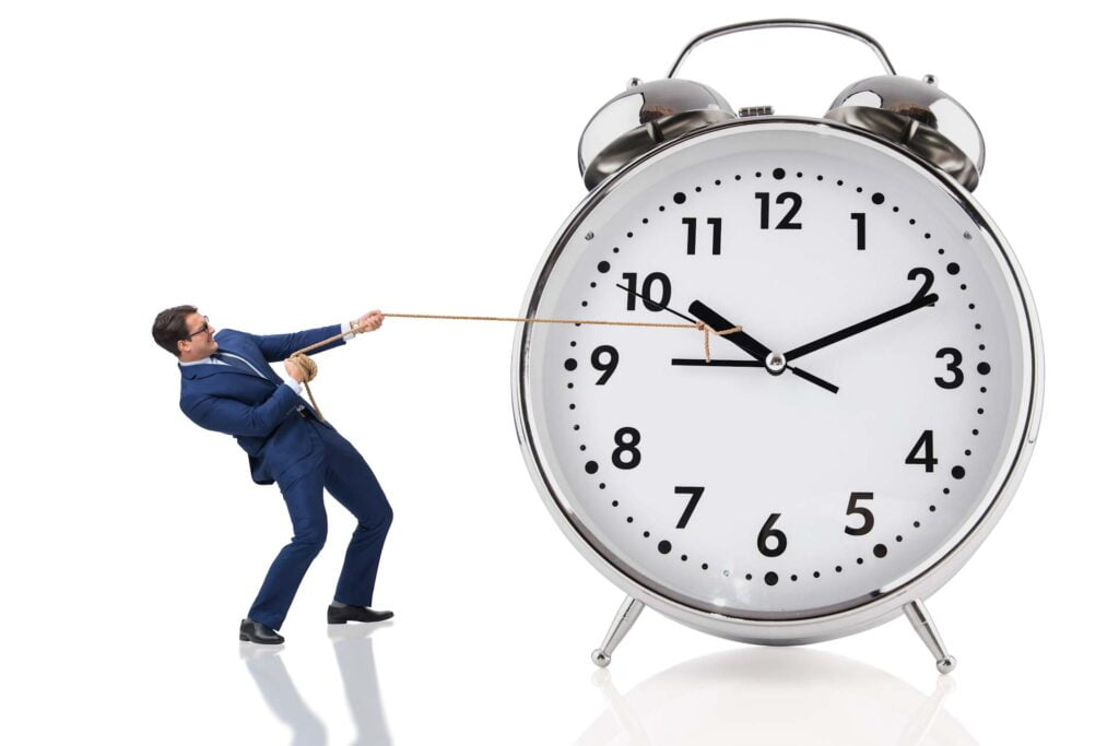 man is pulling clock hand