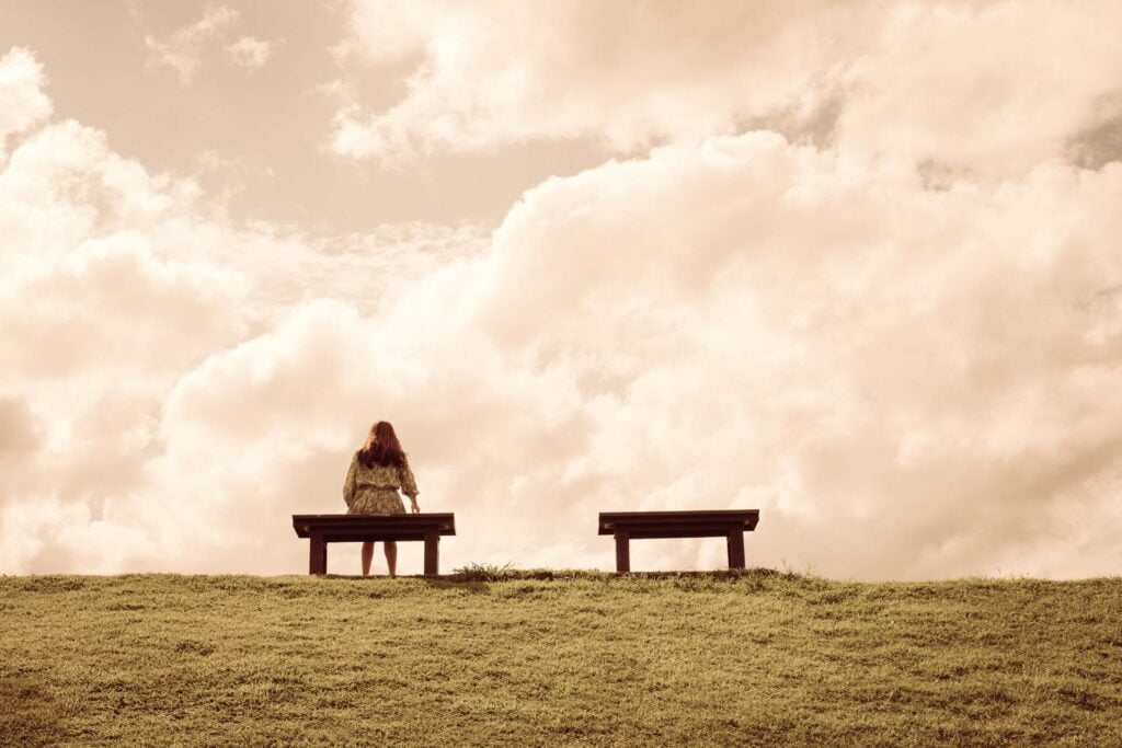 woman waits alon on the bench