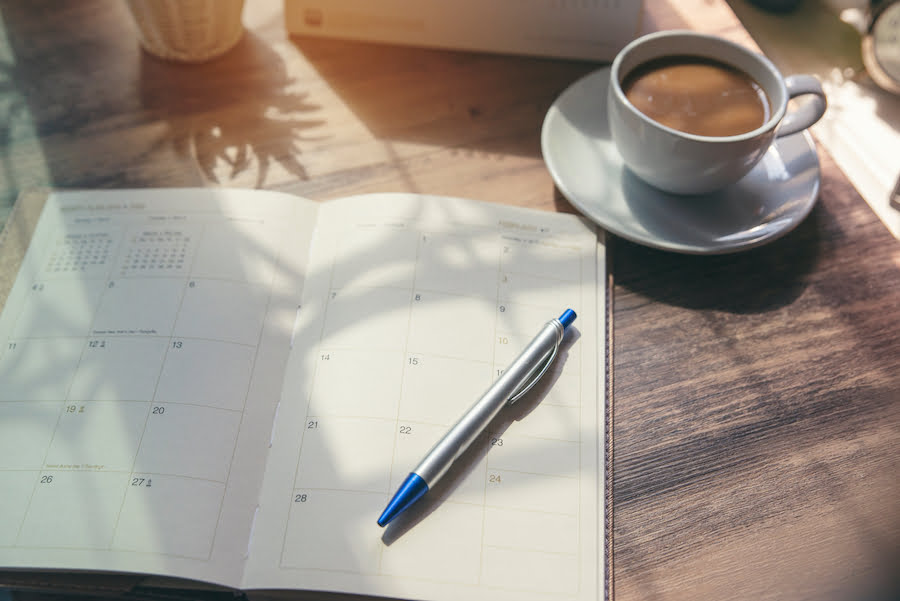 Productivity Planner and a cup of coffee